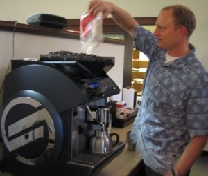 Logos programmer Bryan Albert fills the bean hopper